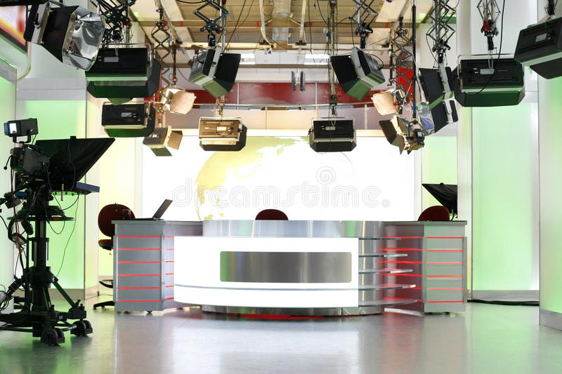 TV news studio setup. Television studio interior with news desk, camera prompter and professional lightning
