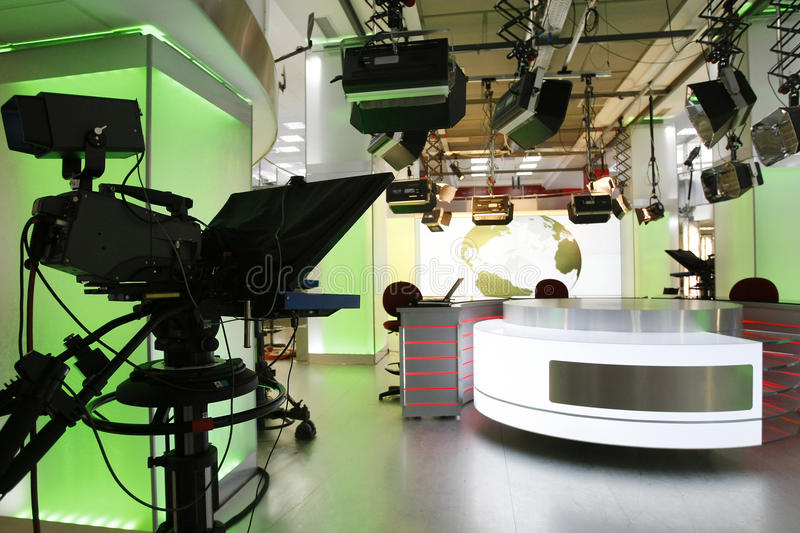 TV news studio setup. Camera prompter and professional lightning in a new television studio with news desk