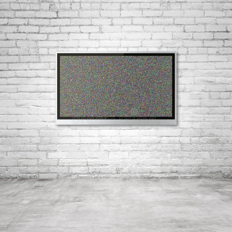 TV på tegelstenväggen royaltyfri foto
