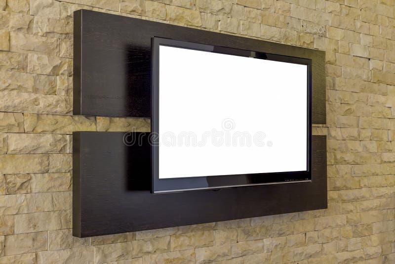 TV på tegelstenväggen royaltyfri fotografi