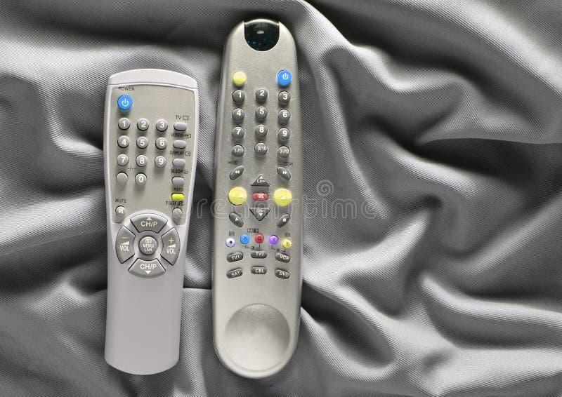 TV piloci do tv na szarym jedwabniczym tle obraz royalty free