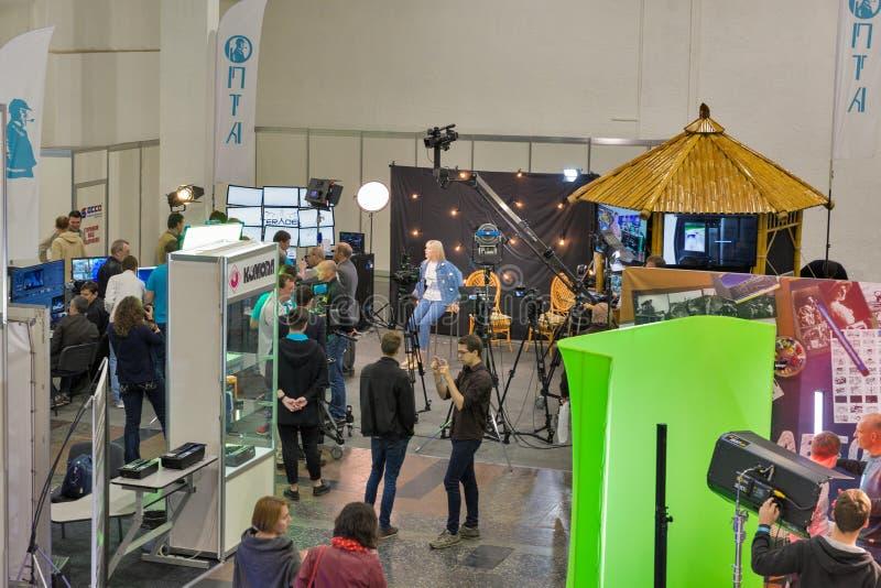 TV and Radio International Fair in Kiev, Ukraine. Unrecognized people visit TV and Radio International Fair in ACCO International Exhibition Center. It is the stock image