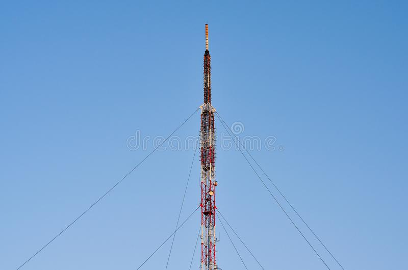 TV and  radio pole   telecommunication antenna. TV and  radio pole   telecommunication antenna  on blue sky background royalty free stock photography