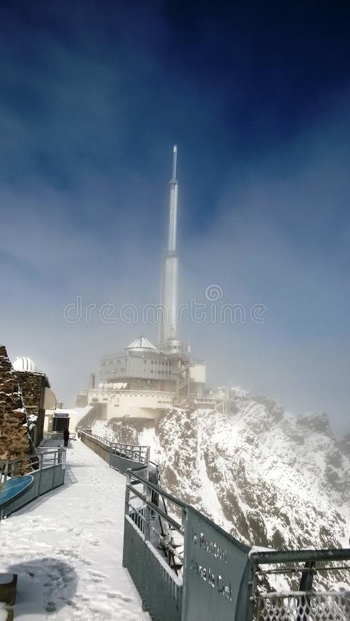 TV radio transmitter at pic du midi in the high Pyrenees in winter under the snow. France stock images