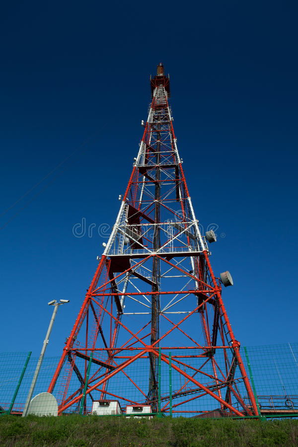 Telecom broadcasting tower under blue sky royalty free stock photo