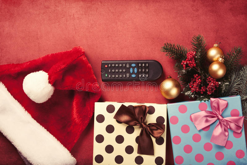 TV remote and christmas gifts royalty free stock image