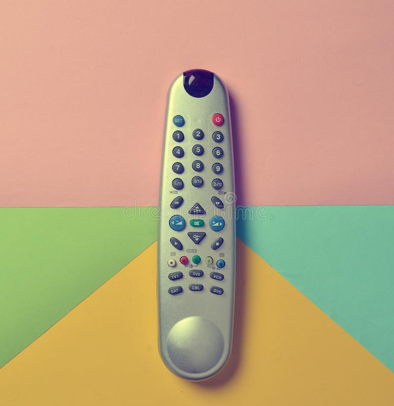 TV remote control on a multi-colored pastel background. TV remote control on a multi-colored pastel background stock photo