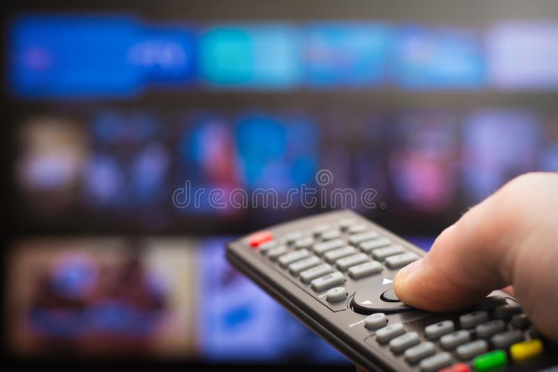 TV remote in hand stock photos