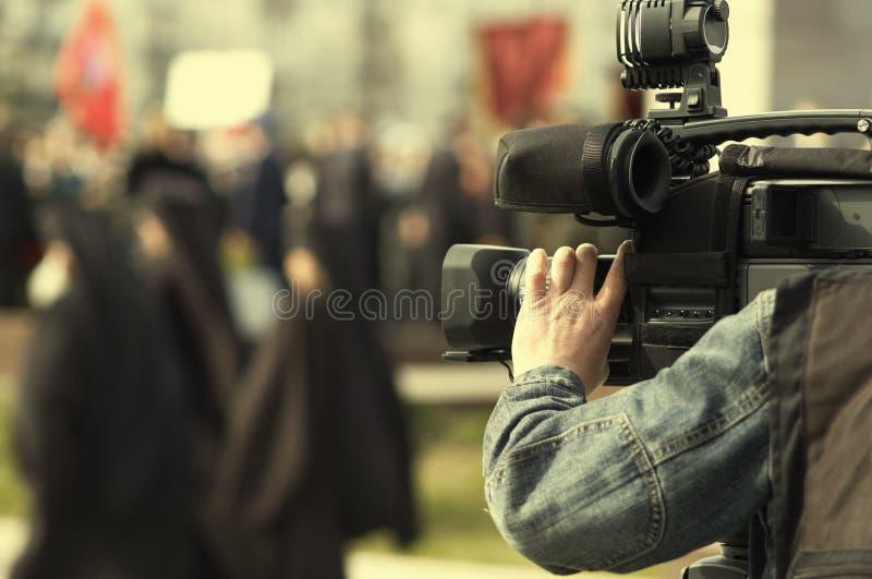 Tv reportage. News cameraman