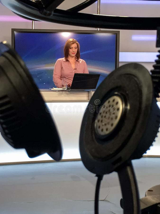 TV reporter at the news desk. TV reporter is live at the news desk presenting the news royalty free stock images