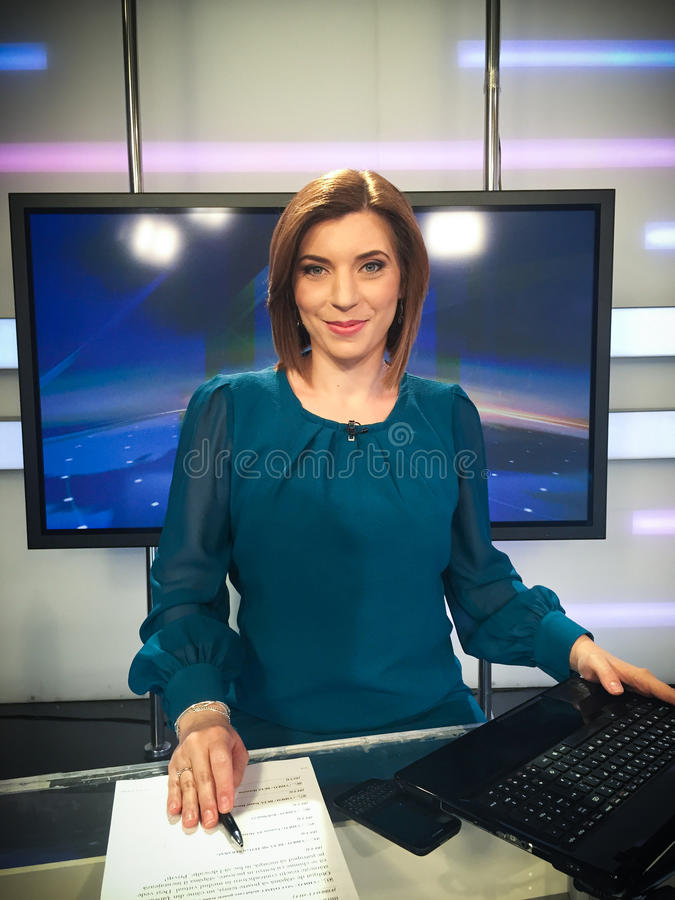 TV reporter at the news desk. Presenting the news stock photography