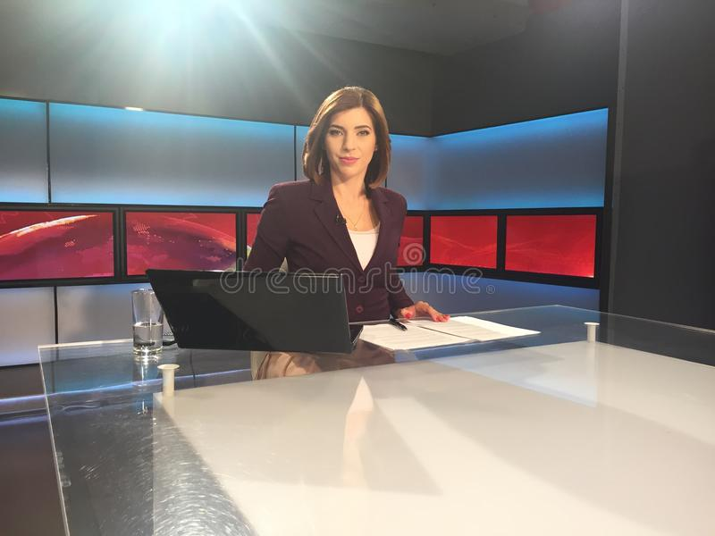 TV reporter at the news desk. Presenting breaking news stock image