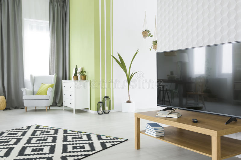 Tv room with 3d wallpaper. Tv living room with 3d wallpaper, armchair and dresser stock photo