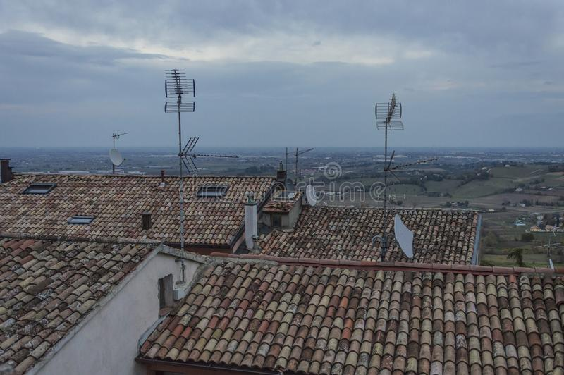 Tv, satellite, broadcasting antennas. Lot of different type of antennas on roof of buildings royalty free stock photo