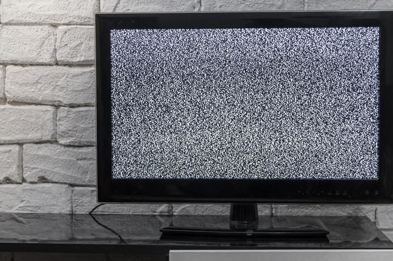 Tv screen with noise glitcher effect. No signal or no communication concept with rustic or loft style innterior. royalty free stock photo