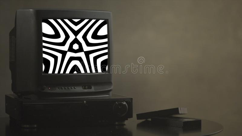 TV shows abstract pictures. TV shows a zombie video on the monitor. TV shows video hypnotizing consciousness.  stock photo