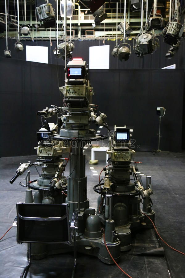 TV studio with camera and lights stock images