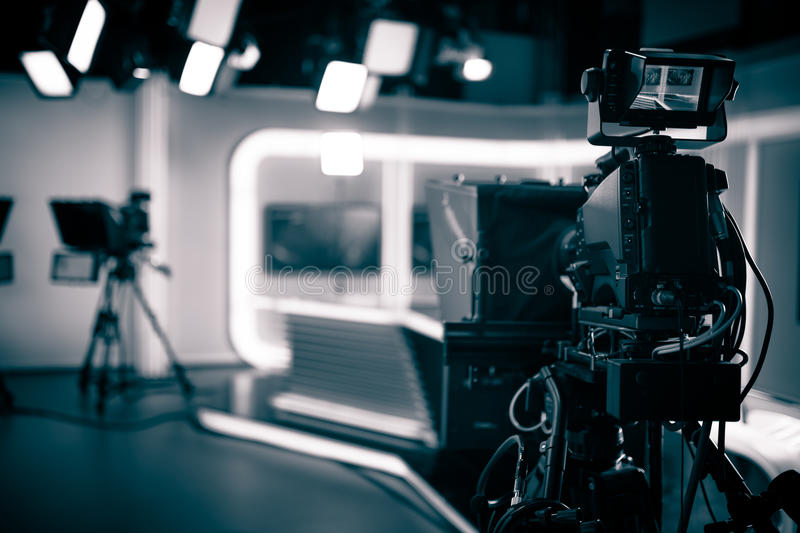 TV Studio live broadcasting.Recording show.TV NEWS program studio with video camera lens and lights. Positioned stage big professional broadcasting camera with royalty free stock image