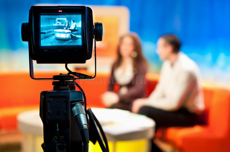 TV studio - Video camera viewfinder. Video camera viewfinder - recording show in TV studio - focus on camera royalty free stock images