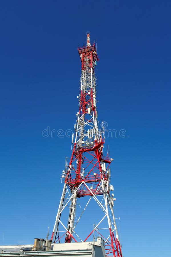 TV tower. Telecommunications lattice tower against the clear sky royalty free stock photos