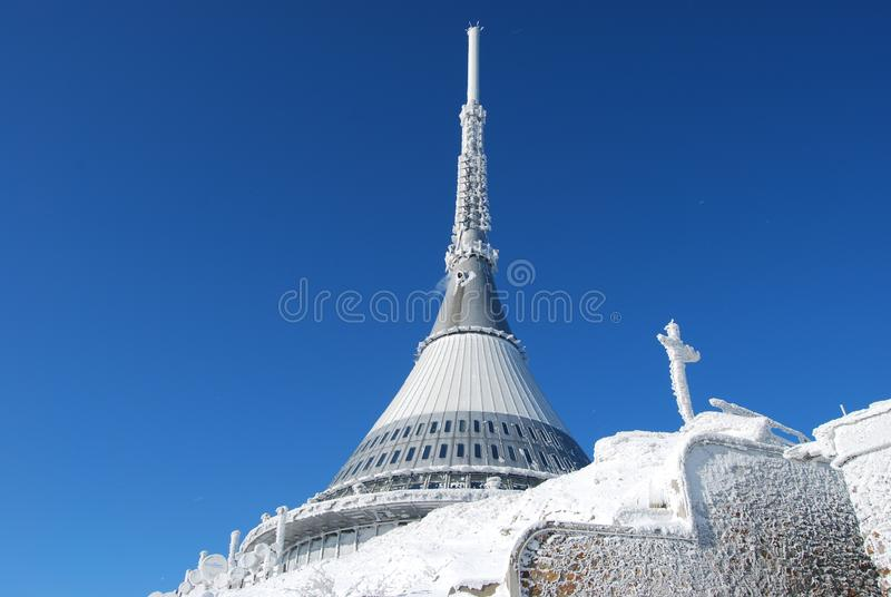 TV transmitter and mountain hotel Ještěd in winter royalty free stock photography