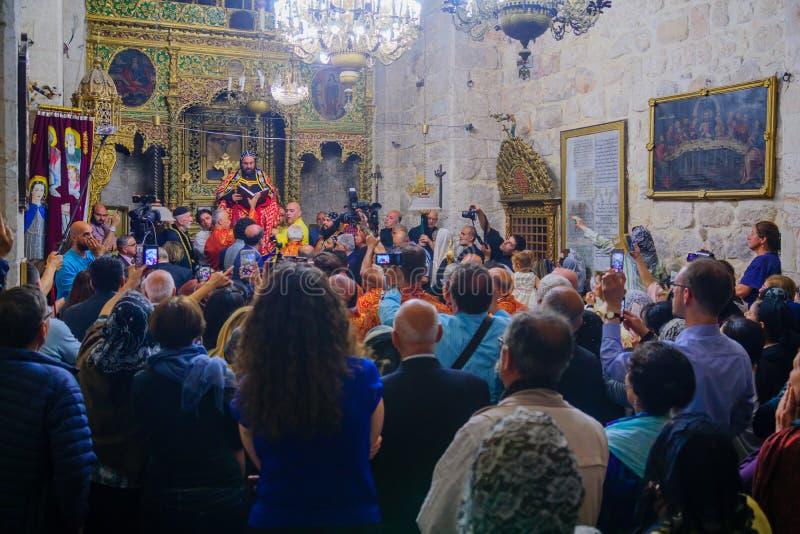 Tvagningen av fotceremonin, i den syrianska ortodoxSten markerar c arkivfoto