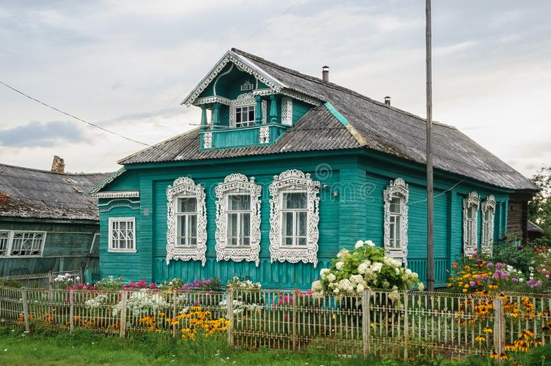 Traditional russian house in village or countryside, richly decorated with carved wooden details royalty free stock images
