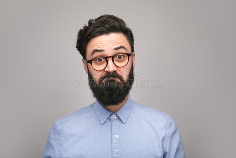 Tvivelaktigt hipster i exponeringsglas arkivbild