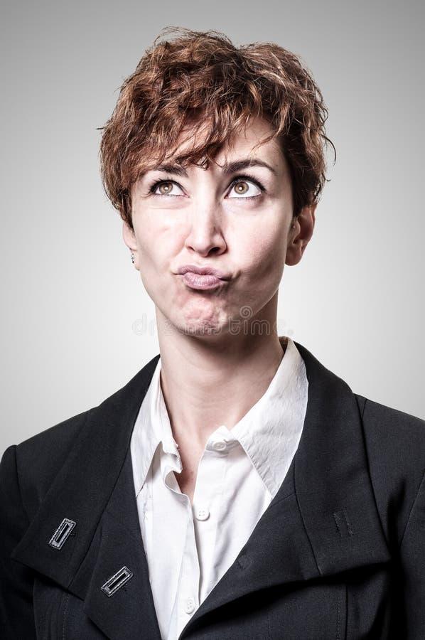 Tvivelaktigtt kvinna för affär för framgångkort stavelsehår arkivfoto