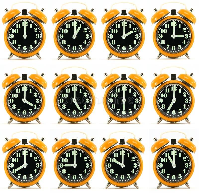 Twaalf oranje urenwekker royalty-vrije stock afbeelding