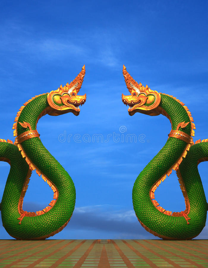 Twain Naga statue of thailand with nice sky. Ancient archaeological archeology stock photography