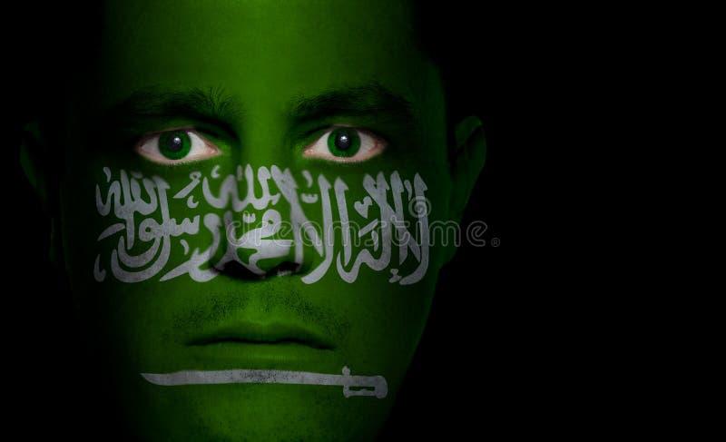 twarz arabskiej dolców saudyjczyk flagę zdjęcie royalty free