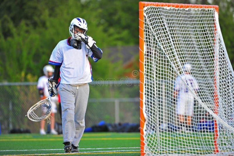 twarz bramkarz lacrosse jego obcieranie zdjęcia royalty free