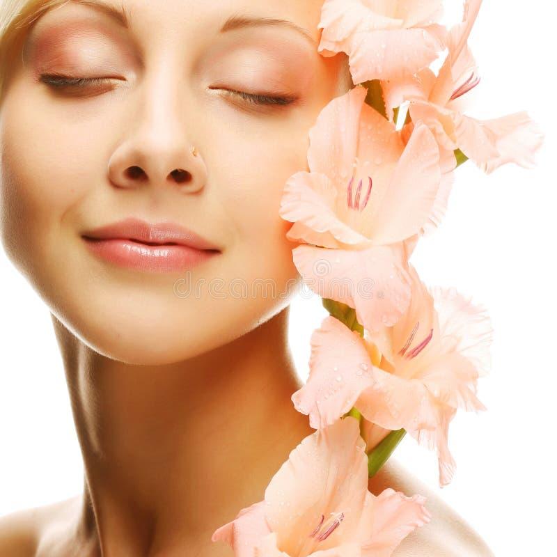 twarz kwitnie świeżego gladiolusa wręcza ona zdjęcia royalty free
