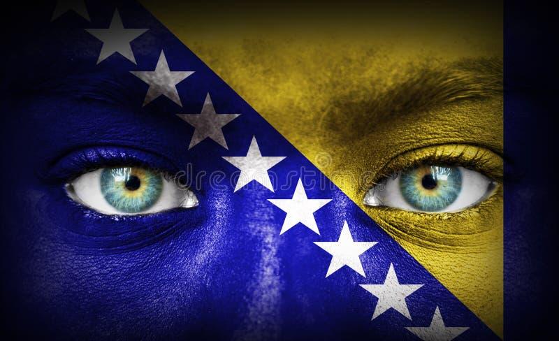 Twarz ludzka malował z flagą Bośnia i Herzegovina fotografia royalty free