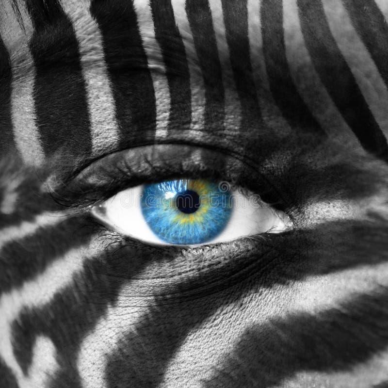 Twarz ludzka z zebra wzorem - Save zagro?onego gatunku poj?cie fotografia stock