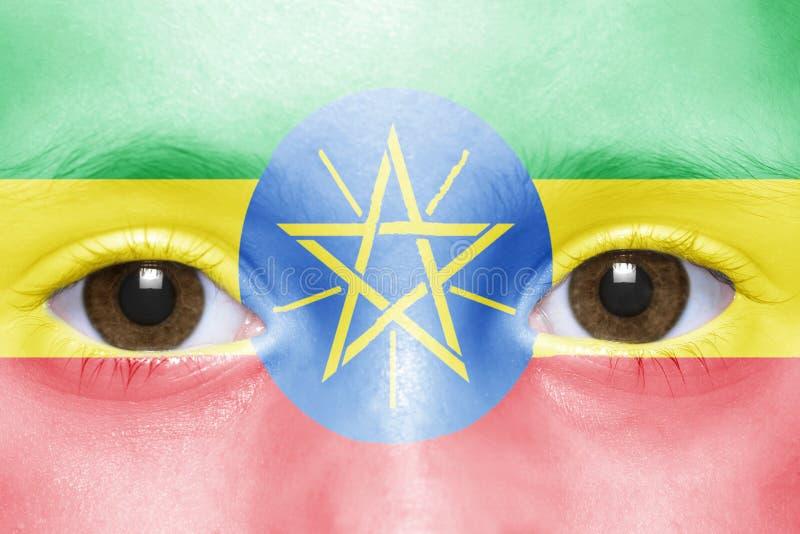 Twarz z ethiopian flaga zdjęcia stock
