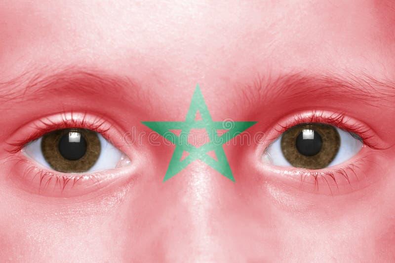 Twarz z marokańską flaga zdjęcie stock