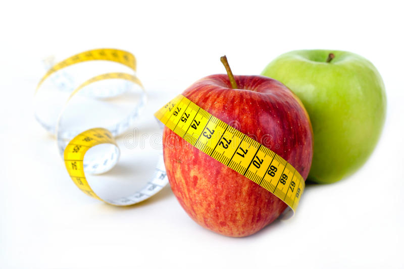 Twee appelen met het messuring van band stock afbeeldingen