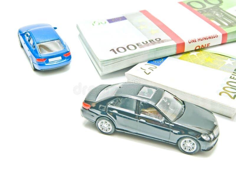 Twee auto's op euro nota's royalty-vrije stock afbeeldingen