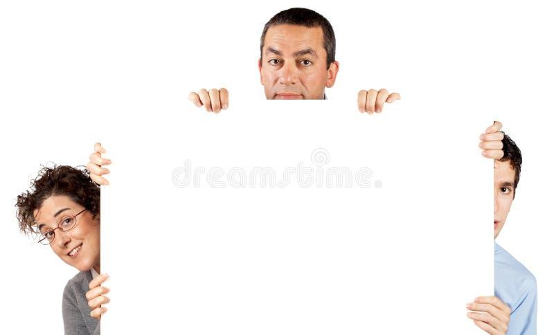 Twee bedrijfsman en vrouw achter theposter stock afbeelding