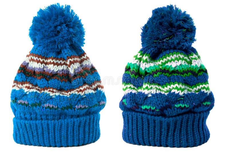 Twee blauwe, warme wol wintermessen ski dat wit geïsoleerd was stock afbeeldingen