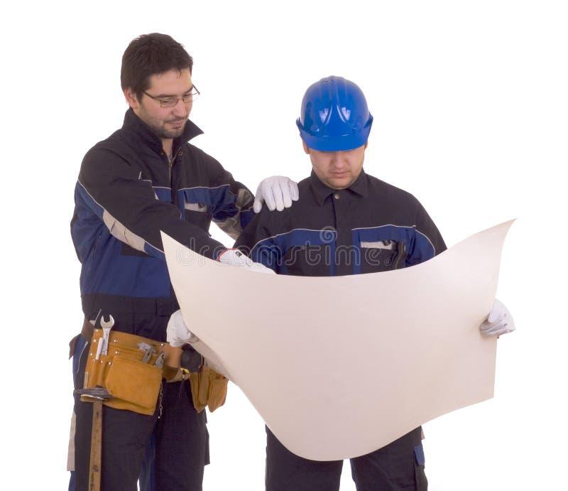 Twee bouwvakkers en het meest projest stock foto