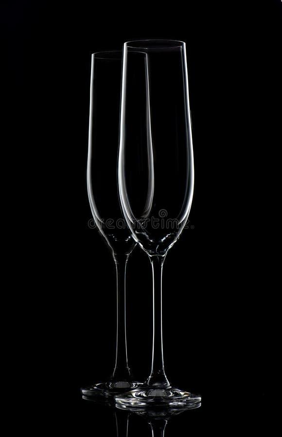 Twee champagneglazen op zwarte royalty-vrije stock fotografie