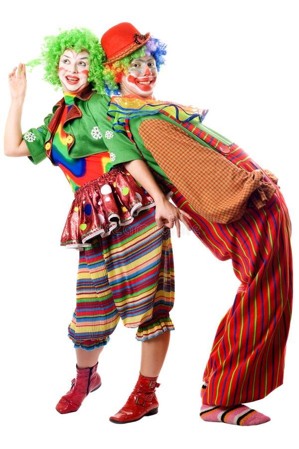 Twee clowns zijn rijtjes stock foto