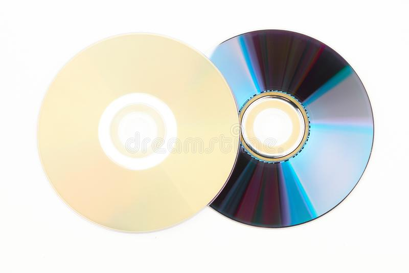 Twee compact-discs op witte achtergrond stock foto's