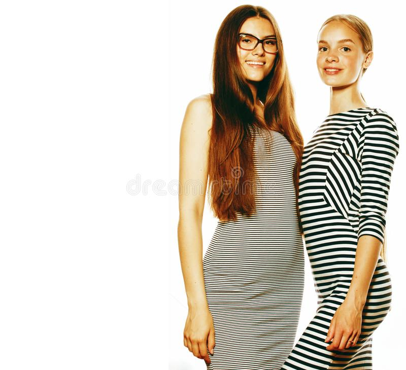 Twee die jonge werknemers op witte, zelfde kleding in strook worden geïsoleerd royalty-vrije stock foto
