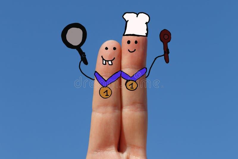 Twee die vingers als kooktoestellen worden geschilderd royalty-vrije stock fotografie