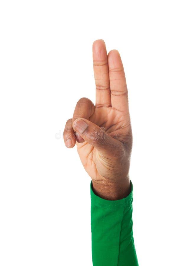 Twee die vingers voor een gelofte worden omgedraaid stock afbeeldingen