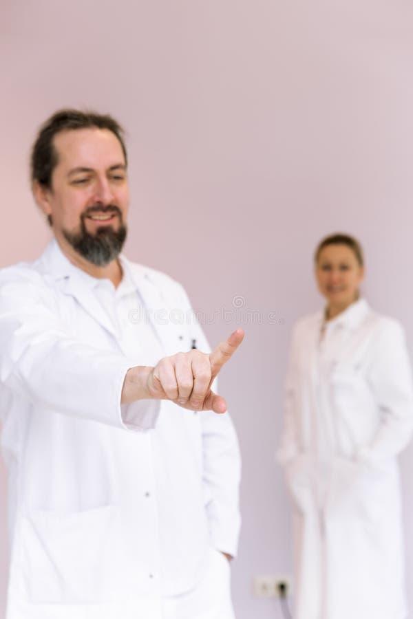 Twee doktersberoeps stock afbeeldingen